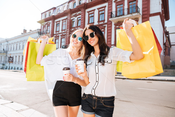 Two elegant happy women walking in the city street Stock photo © deandrobot