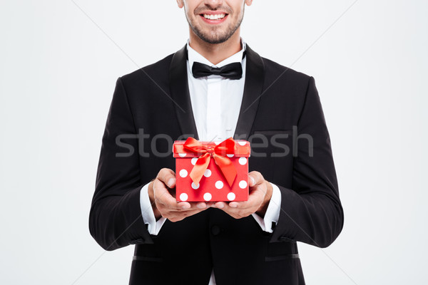 Cropped businessman with gift Stock photo © deandrobot