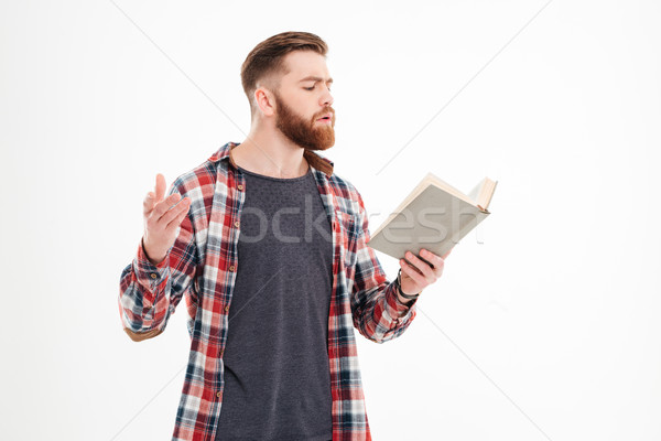 Young bearded man actor reading script Stock photo © deandrobot