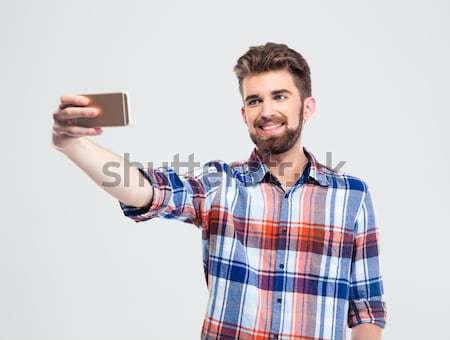 улыбаясь бородатый человека рубашку вызывать Сток-фото © deandrobot