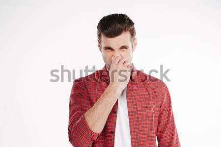 Man covering his nose Stock photo © deandrobot