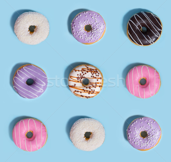 Nine colorful sweeties donuts Stock photo © deandrobot