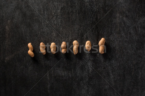 Photo of dried peanuts on dark background Stock photo © deandrobot
