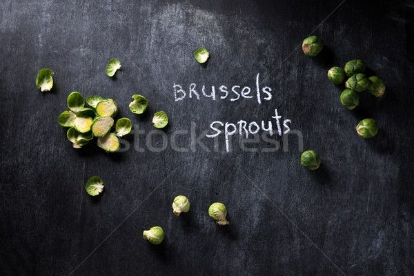 Brussels sprouts over dark chalkboard background Stock photo © deandrobot