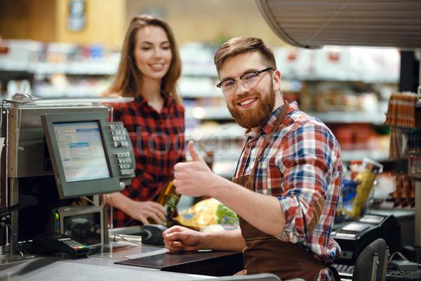 Mutlu kasiyer adam Çalışma alanı süpermarket resim Stok fotoğraf © deandrobot
