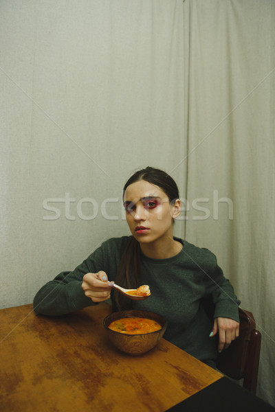 Vertical picture of calm woman eating Stock photo © deandrobot