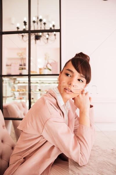 Pensive cute fille séance cafétéria Photo stock © deandrobot