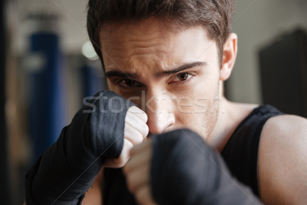 Close up  view of serious boxer doing exercise in gym Stock photo © deandrobot