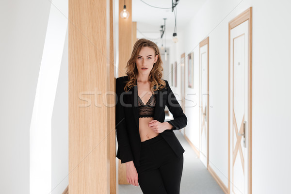 Pretty woman in suit and bra Stock photo © deandrobot