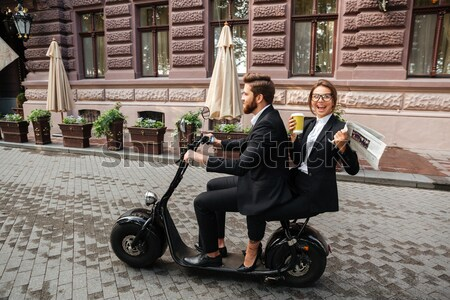 Side view of screaming bearded business man rides on motorbike Stock photo © deandrobot