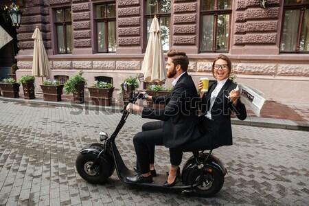 Vue de côté hurlant barbu homme d'affaires moto modernes Photo stock © deandrobot