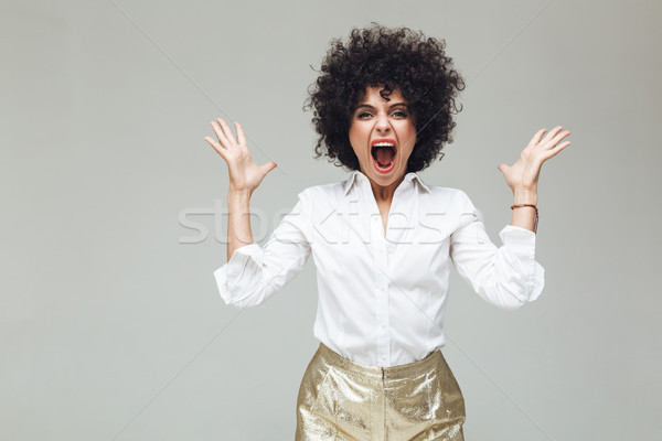 Screaming retro woman dressed in shirt Stock photo © deandrobot