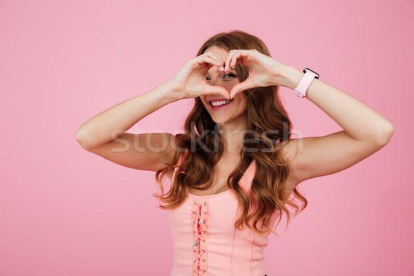 Close up portrait of a smiling happy woman Stock photo © deandrobot