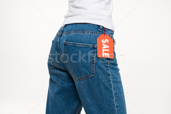 Close up portrait of a female buttocks in jeans Stock photo © deandrobot