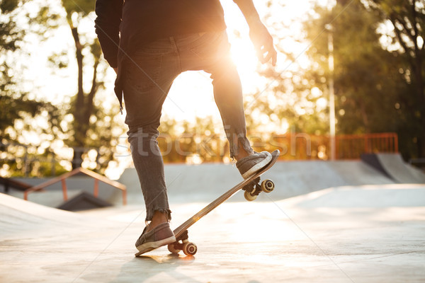 Close up of young male skateboarder training in skate park Stock photo © deandrobot