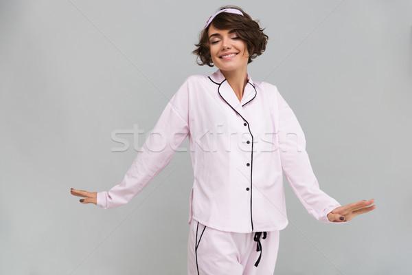 портрет девушки пижама рук довольно Сток-фото © deandrobot