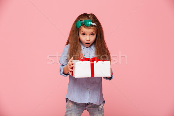 Cute girl 5-6 years holding present box with open mouth being ex Stock photo © deandrobot