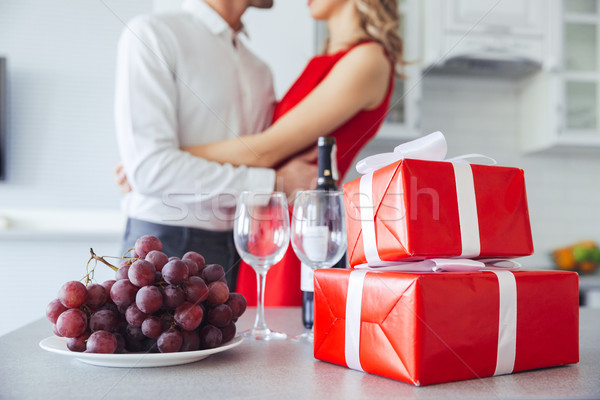 Close up shot of gift boxes, bottle of wine and grape on table Stock photo © deandrobot