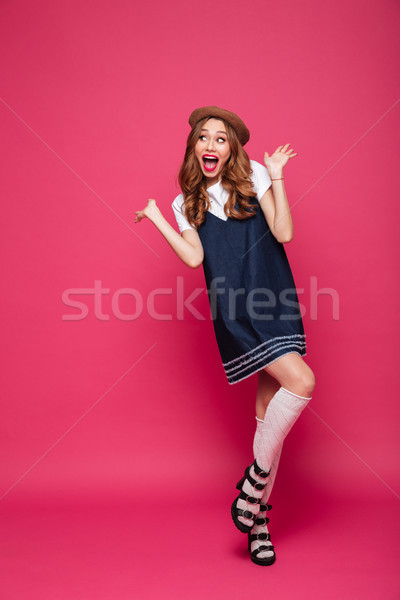 Excited beautiful lady looking camera with opened mouth isolated Stock photo © deandrobot