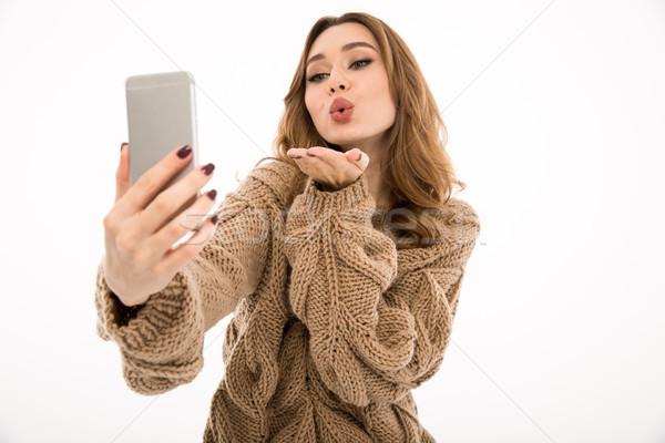 Lady свитер телефон удивительный Сток-фото © deandrobot