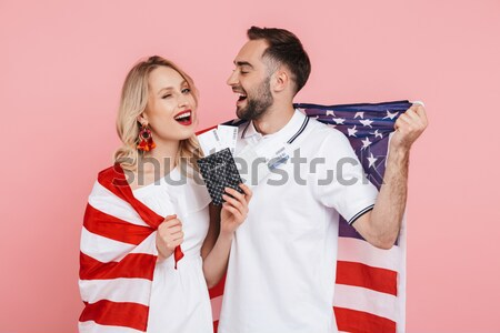 Cheerful screaming punk couple holding money and looking at camera Stock photo © deandrobot