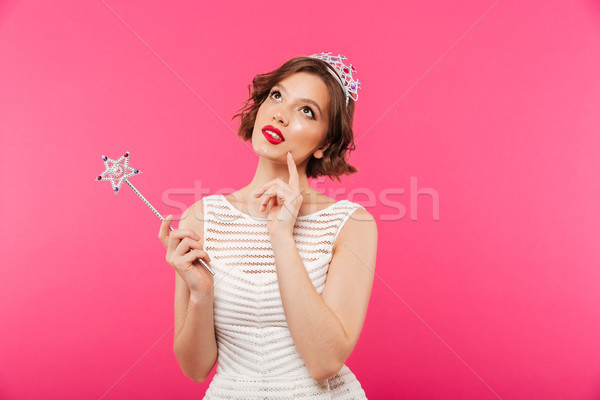 Portrait of a pensive girl wearing crown Stock photo © deandrobot