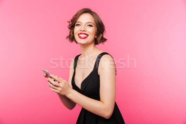 Portrait of a happy girl dressed in black dress Stock photo © deandrobot
