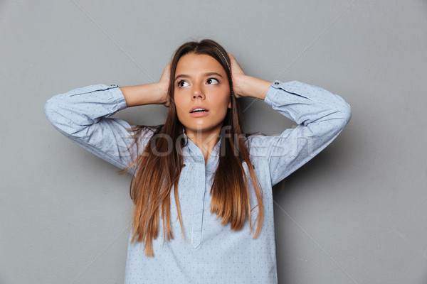 Confused brunette woman in shirt covering her ears Stock photo © deandrobot