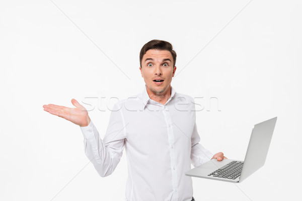 Portrait of a confused frustrated man in white shirt Stock photo © deandrobot
