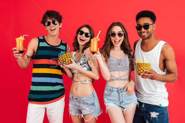 Group of smiling young multiracial friends in summer clothes Stock photo © deandrobot