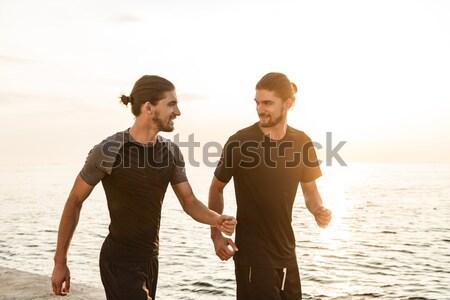 Vrolijk jogging samen strand water Stockfoto © deandrobot