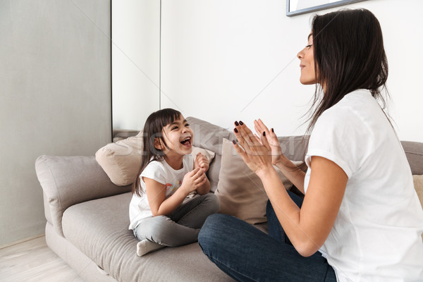 Portrait of laughing caucasian family mother and girl playing to Stock photo © deandrobot