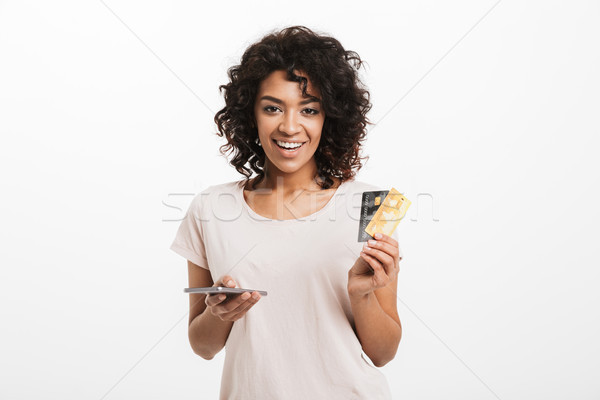 Portrait of a smiling young afro american woman Stock photo © deandrobot