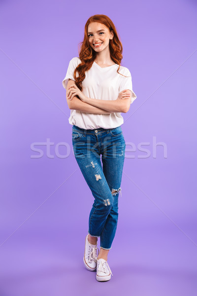 Full length portrait of a smiling young girl Stock photo © deandrobot