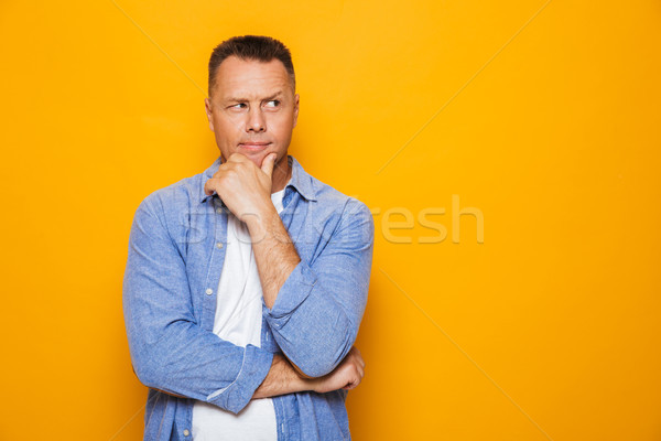 Portrait of a pensive middle aged man Stock photo © deandrobot