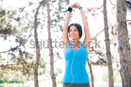 Happy sporty woman using smart watch Stock photo © deandrobot