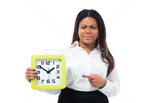Dissatisfied businesswoman pointing finger on the clock Stock photo © deandrobot
