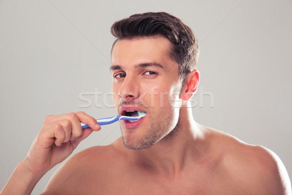 Portret man grijs naar camera Stockfoto © deandrobot