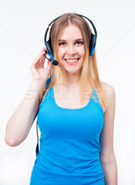 Happy female assistant operator in headset Stock photo © deandrobot