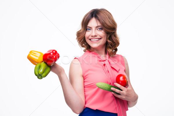 Mosolyog vonzó nő tart zöldségek izolált fehér Stock fotó © deandrobot