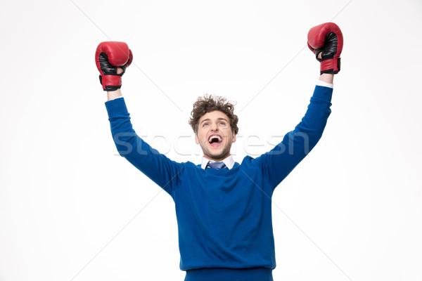 Feliz homem luvas de boxe ganhar branco Foto stock © deandrobot