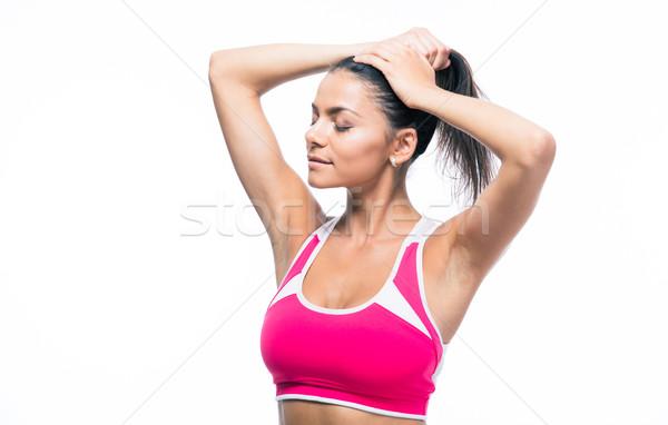 Fitnessz nő készít lófarok izolált fehér kezek Stock fotó © deandrobot