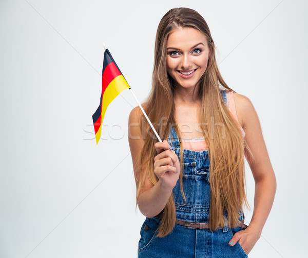 Casual girl holding Germany flag  Stock photo © deandrobot