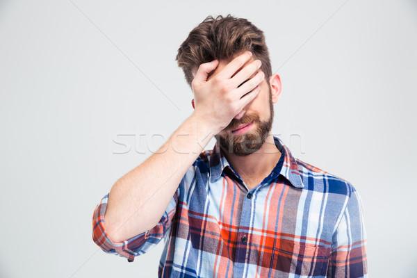 Portre üzgün adam yüz el yalıtılmış Stok fotoğraf © deandrobot