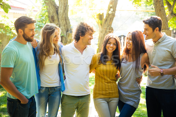 Boldog barátok park napos idő fa tavasz Stock fotó © deandrobot