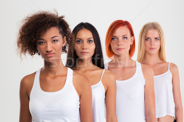 Beautiful four women standing in a row  Stock photo © deandrobot