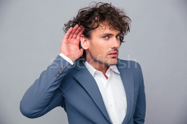 Businessman making gesture to her you Stock photo © deandrobot