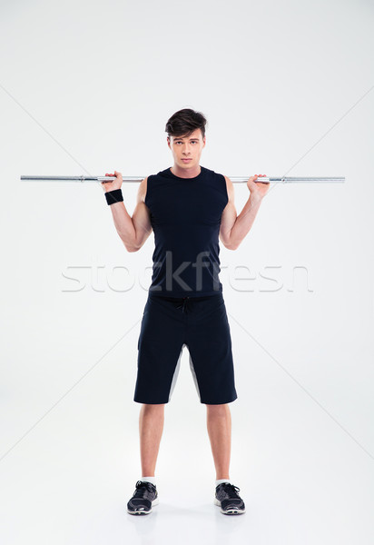 Fitness man workout with barbel Stock photo © deandrobot