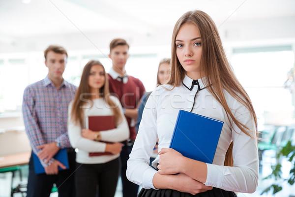 Női diák áll osztálytársak portré gyönyörű Stock fotó © deandrobot