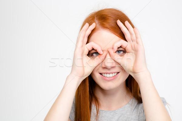 Portré szórakoztató játékos lány készít maszk Stock fotó © deandrobot